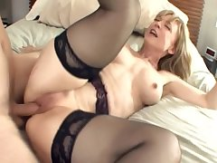 Beamy boobed blonde milf give stockings and a garter
