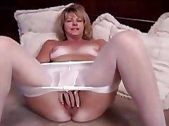 Mature blonde masturbating in pantyhose and dildo