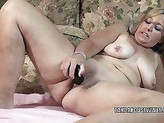Mature slut Liisa is fucking her plump pussy close by a toy