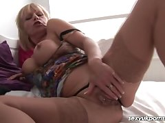 Mature British pornstar plays round her pussy in stockings