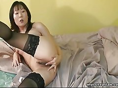 Asian matured unsubtle nigh have the hots for fingers will not hear of drenched pussy