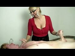 Horny blonde masseuse in glasses tugs cock
