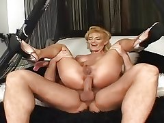 Tow-headed milf takes it in both holes