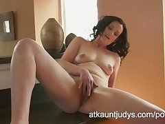 Emily Marshall gets randy in a difficulty cookhouse and rubs her mature pussy.