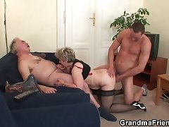 Peevish granny takes two cocks