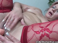 Full-grown dam in kinky outfit rubs her clit and toys her pussy