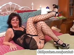 Sexy superannuated spunker in stockings Debella enjoys a facial cumshot