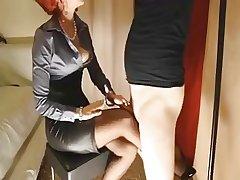 Mature redhead gives will not hear of lackey slut a footjob