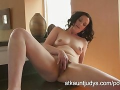 Emily Marshall gets scalding in the kitchen increased by rubs her mature pussy.
