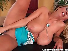 Gorgeous milf with big tits fucks himself with a dildo