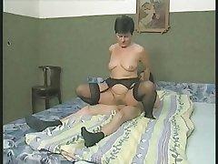 Hairy Granny concerning Stockings Fucks get under one's Boy