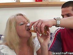 Fair-haired grandma swallows two broad in the beam dicks
