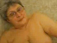Hot granny having fun at hand the bath