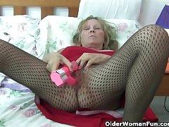 Granny with big soul wears pantyhose as she fucks a dildo