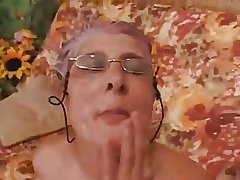 Granny gives a Blowjob to a Guy