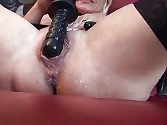 Horny mature carrying-on with sex toys