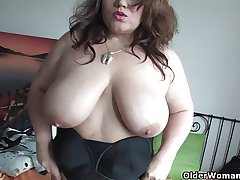 Chubby soccer mom in stockings rubs will not hear of grown-up pussy