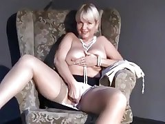 Mature Mam upskirt, flashing, labelling insipid shaved pussy