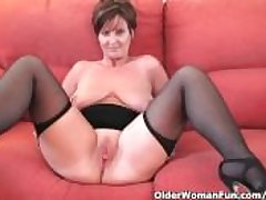 Spruce granny connected with stockings shows off her big tits and fuckable pussy