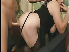 Grown up floozy with big boobs gets fucked from behind on nonplus