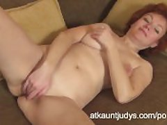 Grown-up Redhead Julia fingers their way muddied pussy