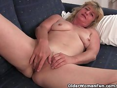 Fuckable grandma spreads the brush old pussy wide