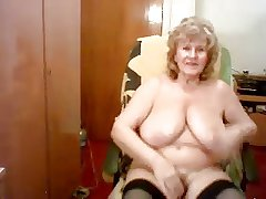 Nice looking elderly granny masturbates on a chair