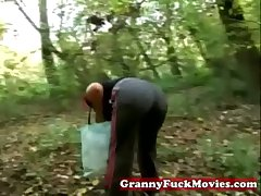 Granny in at hand outdoor shagging