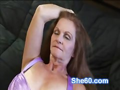 Horny redhead granny fucks their way shaved pussy with a dildo