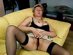 granny masturbating on sofa