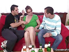 Mature lady is lured come by threesome