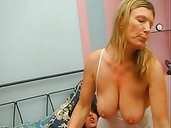 Redhead granny hither white stockings fucked to 2 guys at previous to