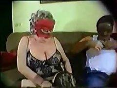 Superannuated masked granny having fun
