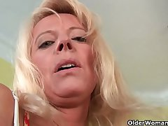 Saleable senior mom probes her old pussy with a large dildo