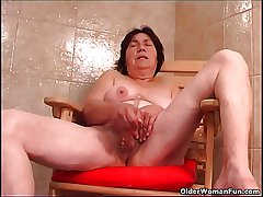 Over 70 granny on touching puristic pussy fucks a dildo