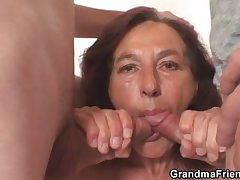 Mischievous distressing granny takes two young dicks