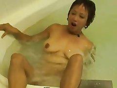 Horny Asian Granny Fucks her Cunt nearly the Hot Tub