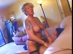 Tattooed Flaxen-haired granny fucked
