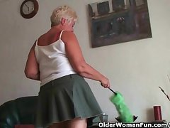 Highly sexed grandma Sandie rubs their way pierced clit